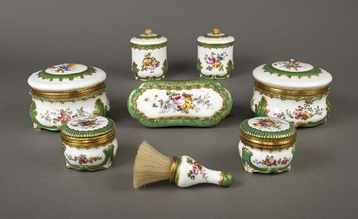 Toilette Service, Manufacture de Sèvres, 1763, Soft-paste porcelain, painted and gilded, Vincennes & Sèvres toilet wares were used for the cosmetics and hair preparations during the ritual of the toilette. In the 18thC this was undertaken before courtiers, friends and tradesmen. This service (probably incomplete) comprises 2 powder boxes, 2 patch boxes, a small brush (vergette) for brushing away wig powder & a clothes brush.  wallacecollection.org