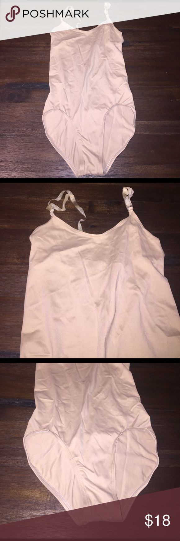 Body Wrappers - Nude Leotard Nude bodysuit with v neck and adjustable straps. Straps are a little worn and could be replaced, but leotard in great condition. Body Wrappers Swim One Pieces