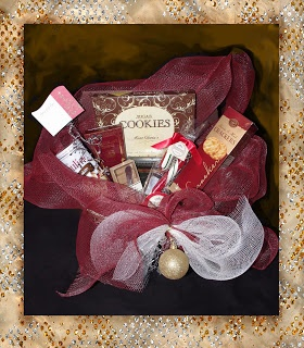 "We wish you a Merry Christmas Basket       A Festively wrapped 15"" handled basket filled with Sugar Cookies, Chocolate Toffee, Pirouline waffers, Crackers, Cheese Spread, Mini Spreader and a Candy Cane   CB001  $48.99  ""Add a bottle of wine and glasses at an extra charge"""