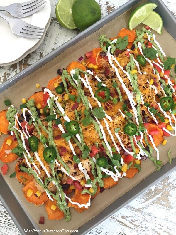 The perfect nacho recipe for tailgating or a crowd of hungry people! Easy to make and absolutely delicious with homemade sweet potato chips!