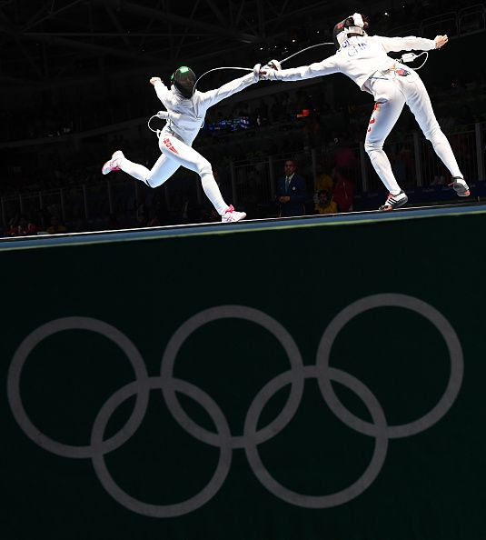 #RIO2016 Best of Day 1 - Tunisia's Sarra Besbes competes against China's Sun Yiwen during their womens individual epee quarterfinal bout as part of the fencing event of the...