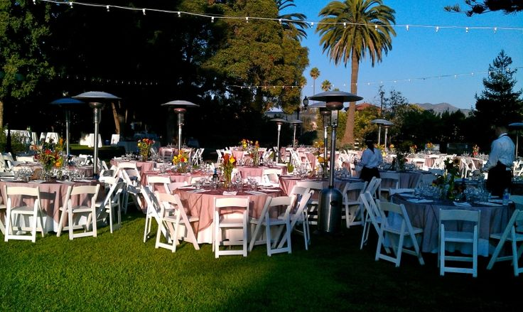 "Photo: Wedding Reception with 60"" round tables, white wood folding chairs string lighting , patio heaters,dance floor set the mood for an amazing night"