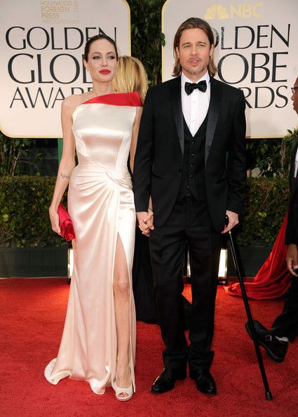 Actors Angelina Jolie (L) and Brad Pitt arrive at the 69th Annual Golden Globe Awards held at the Beverly Hilton Hotel on January 15, 2012 in Beverly Hills, California.