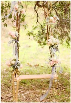 Create a tree swing for Valentine's Day decorated in delicate roses.