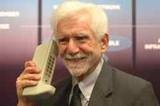 Dr. Martin Cooper of Motorola made the first private handheld mobile phone call on a larger prototype model in 1973.