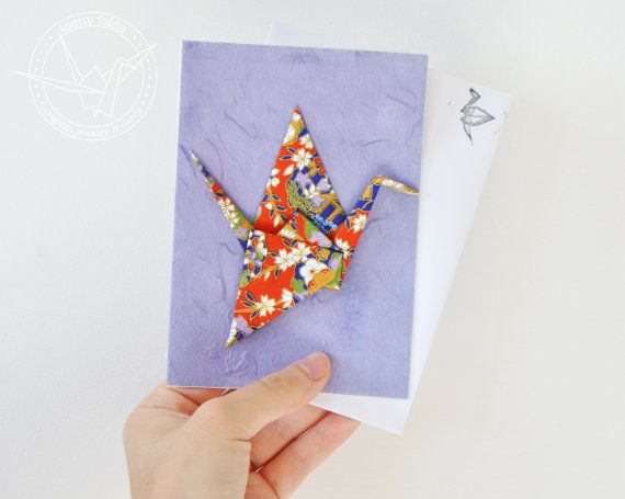 Introducing new origami greeting cards at the Teeny Folds shop on Etsy. These handmade cards are blank on the inside, making it perfect for any greeting, any occasion. This beautiful card is a red and gold floral peace crane on purple card. #etsy #origami #crane #stationery #handmade #cards