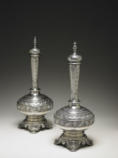This pair of sterling silver flagons was a wedding gift in 1878 to  Josephine Hilton (1856–?) from Cornelia Clinch Stewart (1802–1886), Tiffany & Co., 1874.