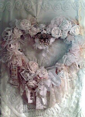 I am so excited to show you this tree! It's romantic... shabby... lacy... ruffley... and Christmasy.  I made this tree from my collecti...