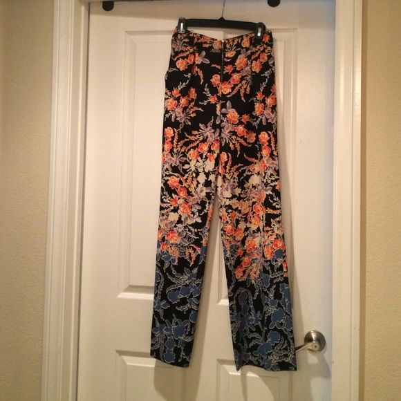 Bcbgmaxaria floral border print pant xxs High waisted oriental floral print with navy back drop and bold orange hues, cream and soft blues and grays to offset the contrast.  Fell in love with this the minute I had it on!  Just tuck in a cream blouse or get a chic ivory cropped top to look ultra posh/sexy/sophisticated.  For fall, put on a crop sweater and scarf with high wedge booties and wide brim hat in camel!  Center front has zipper and button closure and pockets.  Back has back welt…