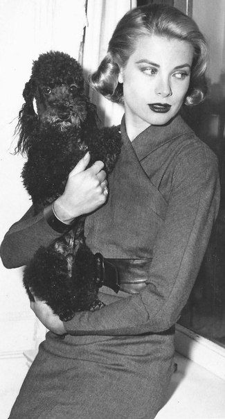 Grace Kelly with her poodle Oliver, 1956