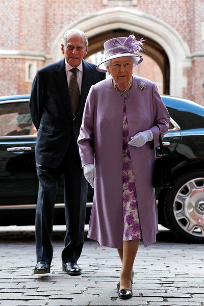 Queen Elizabeth II and Prince Philip, Duke of Edinburgh arrive to attend Evensong in celebration of the centenary of the Order of the Companions of Honour at Hampton Court Palace on June 13, 2017 in London, England.