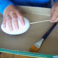 insert skewer into easter egg