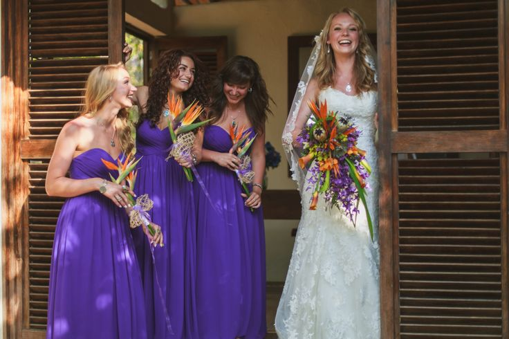 Purple long strapless dresses stand out even more with the tropical flower arrangements.