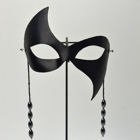Now that you are here, which mask is speaking to you? This seductive little black masquerade mask is perfect for a daring after-hours encounter. Crafted out of high-quality leather and featuring two s