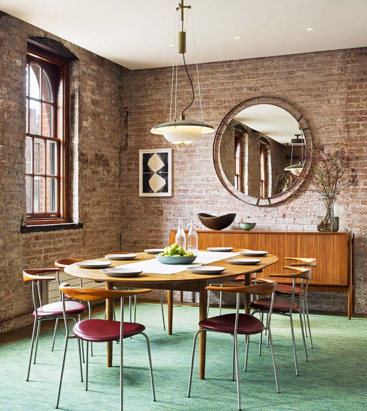 Since these apartments are typically converted warehouses or old industrial buildings, there will usually be a few exposed brick walls throughout the space. We suggest styling your interior around these historic features for a cool Old World meets new mash-up. Midcentury modern furniture, industrial lighting, frameless mirrors, and decorative accents in various metals always pair well with the brick color and texture.