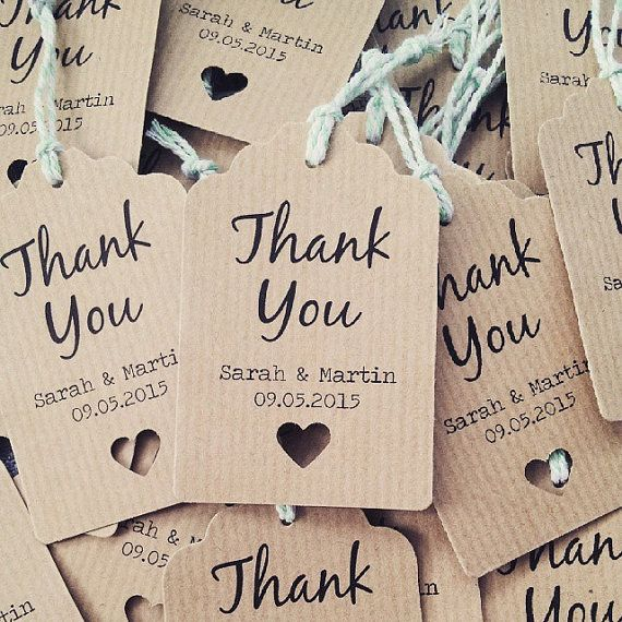16 Beautifully simple personalised wedding favour thank you tags.  These tags are perfect for use on your wedding tables as tags for your favours or to use attached to thank you gifts for your guests, what ever the use these tags will a beautiful addition!  Personalised with your names and wedding date and printed on to a beautiful linen effect white card with a little cut out heart adding simple detailing to each tag.  The tags are printed single sided onto linen effect white card and…