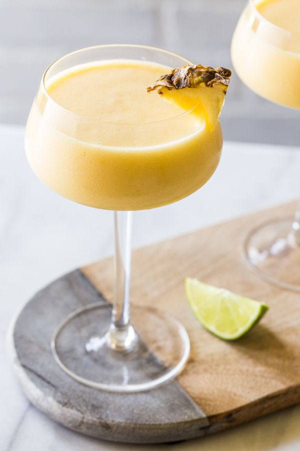 A Frozen Pineapple Mango Daiquiri is the ultimate hot weather cocktail: smooth, cold, fruity and not-too-sweet. They're perfect for summer!