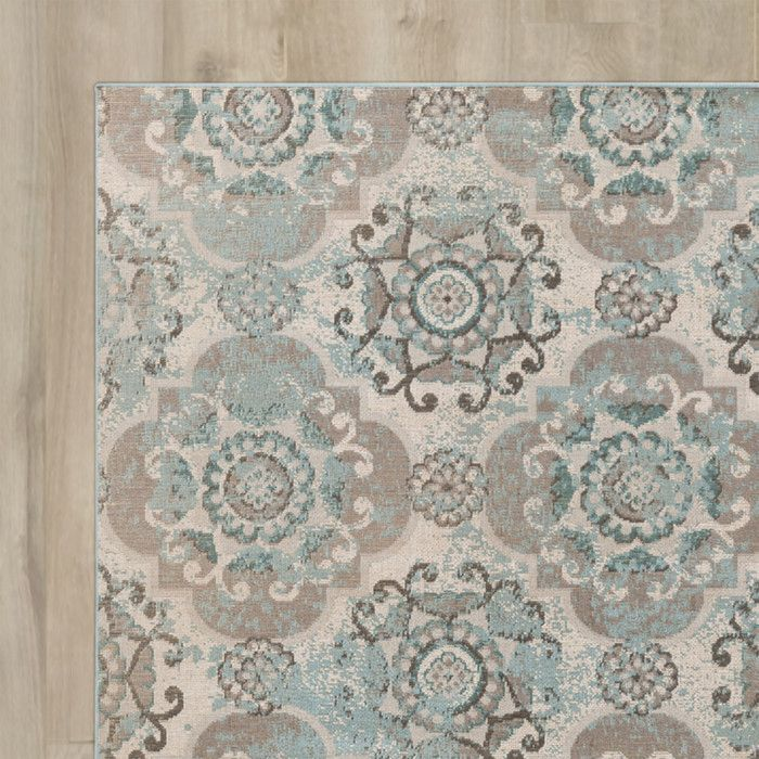 "Features:  -Material: 100% Polypropylene.  -Color: Teal and beige.  -Machine made.  Technique: -Machine woven.  Primary Color: -Teal; Beige.  Product Type: -Area Rug. Dimensions:  Pile Height: -0.5""."
