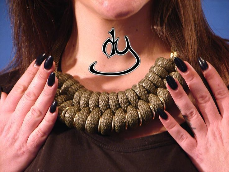 Army Style statement necklace with gold colored rings and paracord. From our ARMY COLLECTION