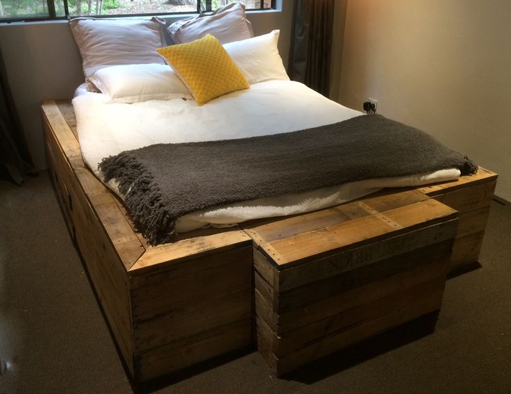 A Custom bed frame that I made from recycled timber pallets! Made for a queen size bed with a blanket box included!