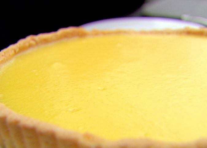 Lemon Curd Tart  | For the lemon curd:  4 lemons, at room temperature  1 1/2 cups sugar  1/4 pound (1 stick) unsalted butter, at room temperature  4 extra-large eggs, at room temperature  1/8 teaspoon salt    More: http://www.foodnetwork.com/recipes/ina-garten/lemon-curd-tart-recipe/index.html