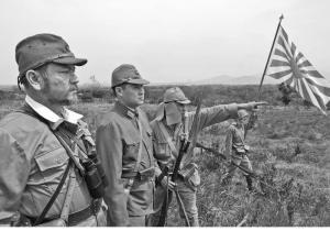 Imperial Japanese Army reenactors survey the terrain.  (Courtesy Panzergrenadier.net) Battan Batle