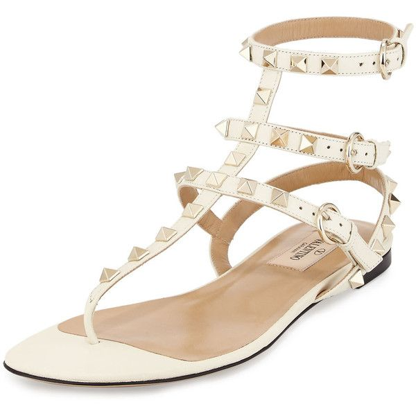 Valentino Rockstud Leather Gladiator Sandal ($1,000) ❤ liked on Polyvore featuring shoes, sandals, lt ivory, valentino shoes, flat gladiator sandals, roman sandals, ivory sandals and ivory flats