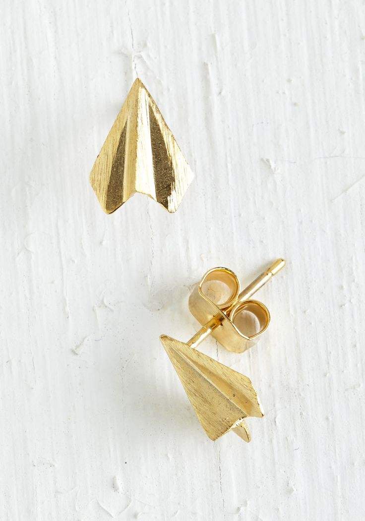 Plane and Simple Earrings in Gold. Take your love for quirky accessories to new heights with these golden, paper airplane-shaped earrings! #gold #modcloth