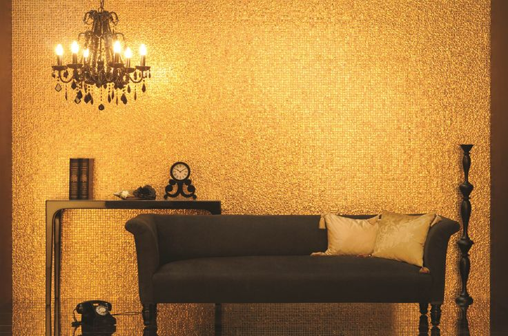 Original Style's Eastern Light mosaic tiles are made from 24 carat gold leaf, ripple textured and encased in glass.
