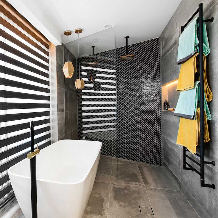 Beautiful bathroom with black and brass tapware