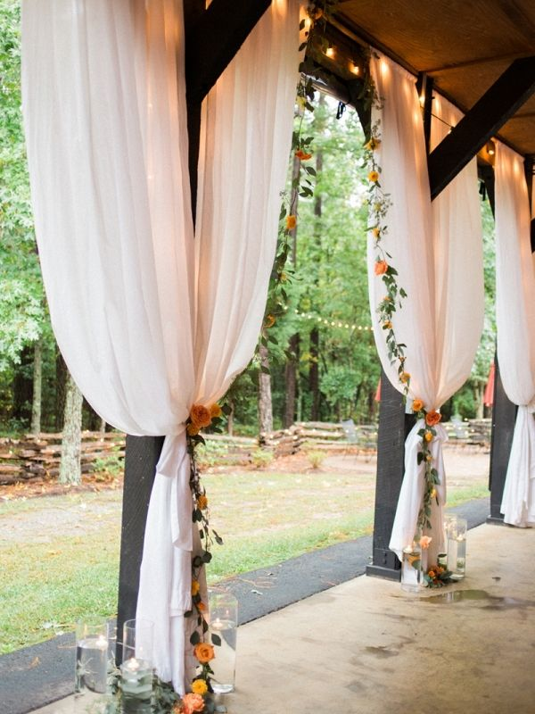 Draped Barn Wedding Ceremony With Twinkle Lights And Flower Garlands