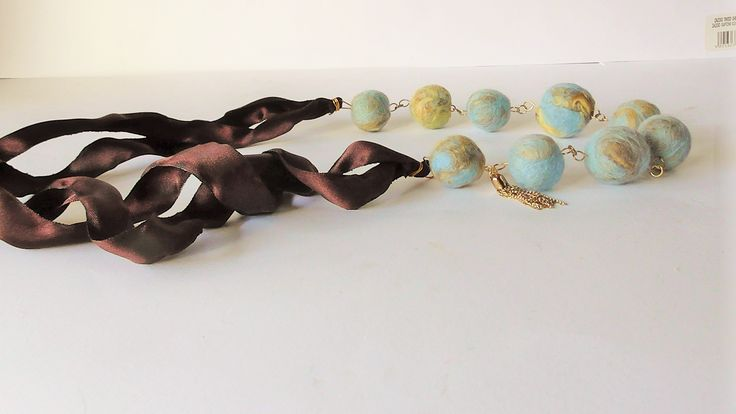 Necklace with handmade felt beads and satin ribbon.