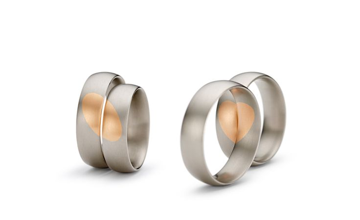 Niessing Heart's desire wedding ring, also available in yellow and gray gold, gray and yellow gold, or red and gray gold as pictured. Available from www.davidsonjewels.com