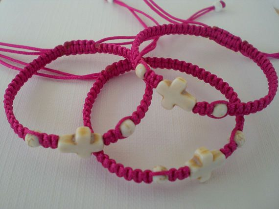 Girls martyrika bracelets. Baptism favors for the Greek orthodox baptism or the First Communion. Witness cross. Macrame bracelets. I used polyester cord to make the bracelets. The cross and beads are by kaolin ( howlite ). The bracelets length is adjustable. The width is 4 mm. The cross is 10