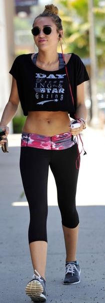 Who made Miley Cyrus' black capri pants, round sunglasses and print short top?