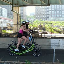 ElliptiGO - Wikipedia, the free encyclopedia = ElliptiGO riders stand up on seatless treadle bicycle= ElliptiGO is an elliptical trainer and bicycle cross first created in 2010.[1] Fourteen Olympians train on them and company cofounder Bryan Pate plans to attempt the Pike's Peak Cycling Hill Climb and Mount Evans Hill Climb using one.