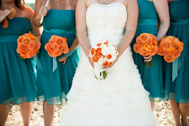 Aqua blue is an elegant choice for summer weddings; Bride's maids look gorgeous with those dresses and the mix with orange brings a touch of modernity. Photo by Lauren McConnell Photography. An idea from the blog Every Last Detail.