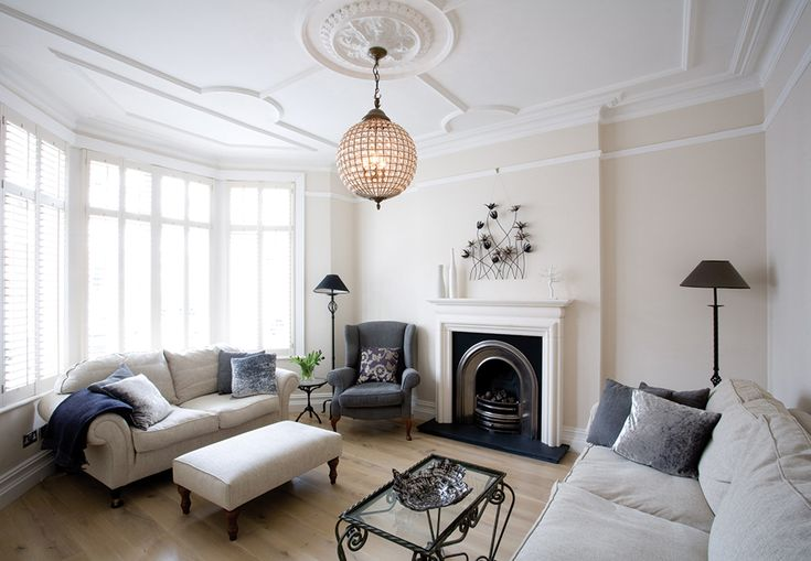 Traditional living room with a concealed television