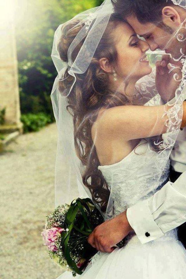 Love the veil and the private moment captured. Sweet
