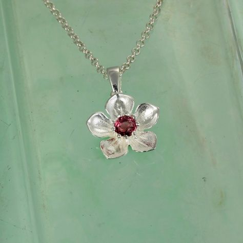 Pink Tourmaline Posy Pendant £49.00 A stunning deep pink tourmaline set in handcrafted sterling silver flower pendant All of our silver jewellery comes beautifully packaged in our new Christin Ranger branded boxes.