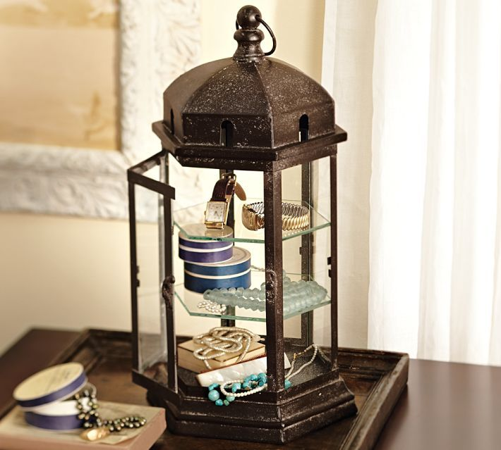 Using an old lantern to store your jewelry is a unique way to display your jewelry while adding to the room's decor.   Spotted at Pottery Barn.