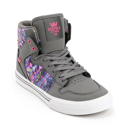 Leap into color with the stylish and durable Supra Vaider high top skate shoes for girls. Featuring Charcoal Grey nubuck upper with multicolor print nylon, these kids sized high tops come equip with padded mesh lining, a vulcanized outsole for board grip and feel, and Pink accents throughout for added style. The Charcoal Grey Vaider for kids from Supra is a durable grown up shoe built for any girl whose style is beyond her years.