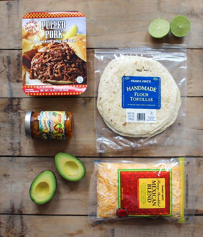 Pulled Pork Tacos TJ BBQ Pulled Pork TJ Tortillas TJ Mango Salsa TJ Shredded Mexican Blend Cheese Avocado  Heat up the pulled pork. Then pile on tortilla with mango salsa, cheese and avocado. That's it!