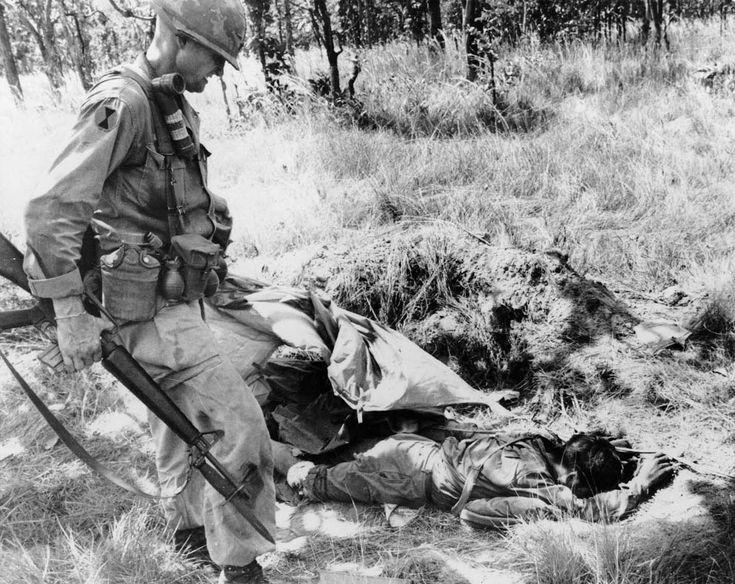 Colonel Hal Moore inspecting NVA dead November, 1965. ~ Vietnam War