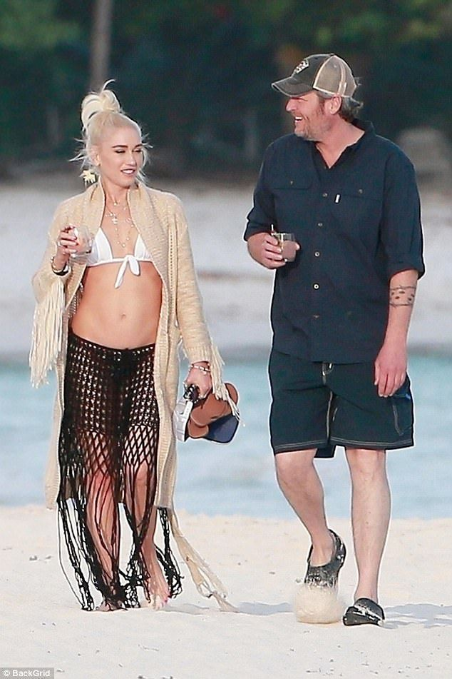 Happy days:Gwen Stefani proved she is as loved-up as ever with beau Blake Shelton as they were seen ambling along the shores in Playa del Carmen in Mexico - during which she showed off her famous abs