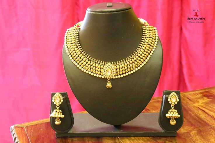 Dare to dazzle any occasion with this gold toned necklace and earring set. The finely detailed pearl and stone work gives it a very elegant and classy look. Jewelry on rent available at Rent an Attire  Try it♡ Book it ♡ Flaunt it~ Rent an Attire  #fashion #beauty #rentanattire #thejewelbox #bridaljewellery
