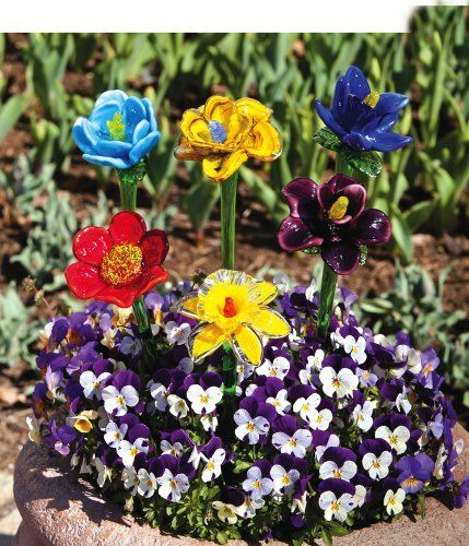 """6 Assorted Garden Flower Stakes by Outdoor Decor. $67.49. Vivid colors. Brilliant Design.. 3.5"""" L x 3.5"""" W x 19.75"""" H. From the Garden Stake Collection.. Flower stakes made of glass.. Great for yourself or as a gift!. These flower stakes are simply beautiful. Each of the 6 unique flowers begins with a long, glass stem, containing a natural green tinge. The stem continues to the flower itself, which explodes with colors. Each flower is brilliantly designed. You simply m..."""