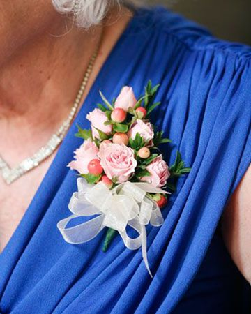 Corsage for the mother of the bride and the groom's mother- The corsages are made with petite roses and local berries.