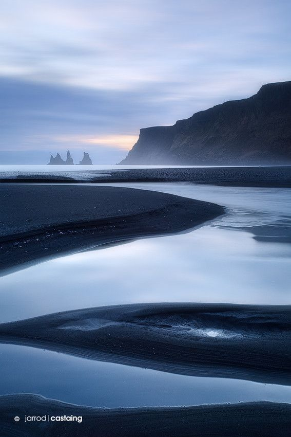 Sunset over black sand beach at Vik i Myrdal, South Coast, Iceland
