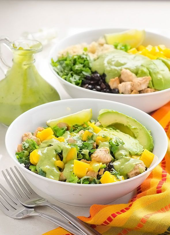 Mango and Black Bean Superfood Bowls -- Quick dinner with quinoa, kale, chili chicken, mango, black beans, cilantro, jalapeños and creamy Cilantro Avocado Dressing. #cleaneating #glutenfree